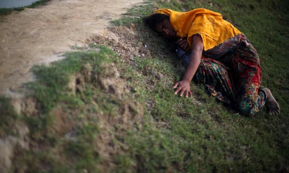 Rohingya refugee lies on the ground
