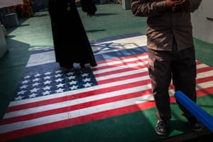 Cruise passengers walk over American and Israeli flags painted on the deck of their cruise boat