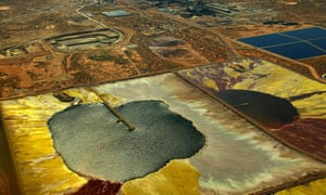 An aerial view of WMC Resources' Olympic Dam uranium mine - the world's largest uranium deposit - in the remote outback of South Australia, 22 November 2004. Areva of France, the world's largest nuclear engineering group, announced plans on 24 February 2005 to offer more than 1 billion euros (USD 1.3 billion) for a stake in the Olympic Dam complex. AFP PHOTO/Colin MURTY AUSTRALIA OUT, NO INTERNET (Photo credit should read COLIN MURTY/AFP/Getty Images)