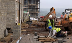 Construction workers build new houses on a residential building site in Paulton on November 21, 2011 near Bristol, England.