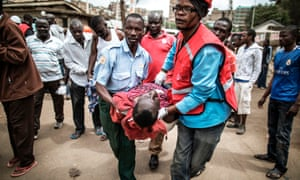 Kenya Red Cross emergency workers take care of a wounded man in Nairobi.