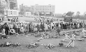 Mourners at the spot where Kennedy assassinated.