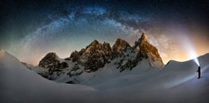 Frozen Giant Nicholas Roemmelt (Germany) The celestial curve of the Milky Way joins with the light of a stargazer's headlamp to form a monumental arch over the Cimon della Pella in the heart of the Dolomites mountain range in northeastern Italy.
