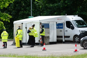 Staff at a mobile testing centre in Slough today, where surge testing is taking place.