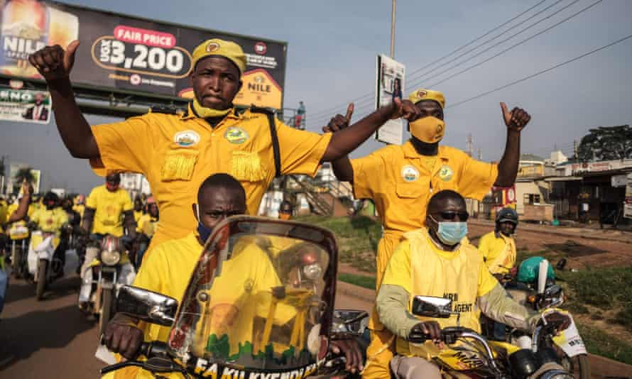 Supporters of incumbent Ugandan President Yoweri Museveni celebrate his election victory on the streets of Kampala yesterday.