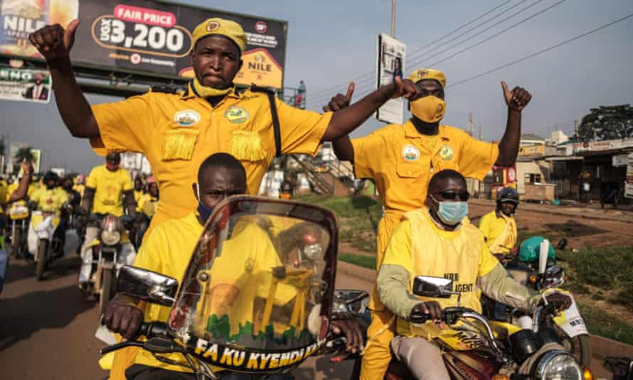 Supporters of incumbent Ugandan president Yoveri Museveni celebrate in the streets of Kampala.