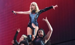 Taylor Swift and dancers on stage