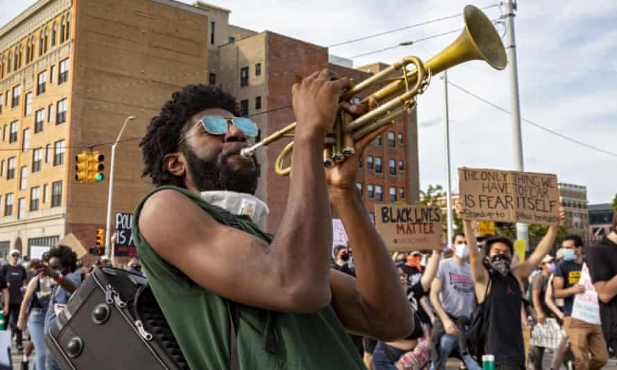 Protesters rally for the sixth day running in Detroit on Wednesday in protest at the killing of George Floyd.