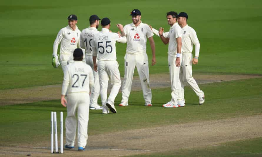Dom Sibley (centre) celebrates after running out Asad Shafiq on day three at Old Trafford.