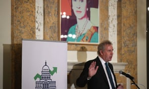 Kim Darroch, who resigned as ambassador to Washington this weeks, speaks at the British embassy in 2017 beneath a Warhol portrait of the Queen.