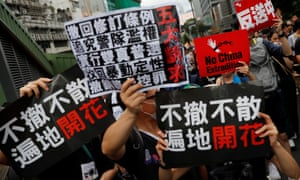 Anti-extradition bill protesters march to West Kowloon railway station in Hong Kong