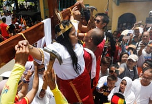 Filipino penitent Precy Valencia is nailed to a wooden cross in Paombong, Philippines