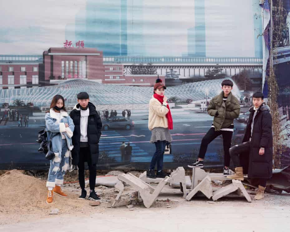 A group of students who are about to take an art exam stand in front of promotional posters in an image from Freezing Land