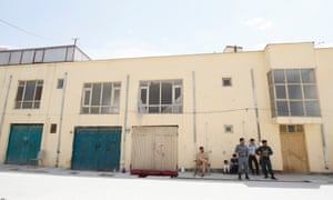 Afghan security officials outside the building that was attacked.