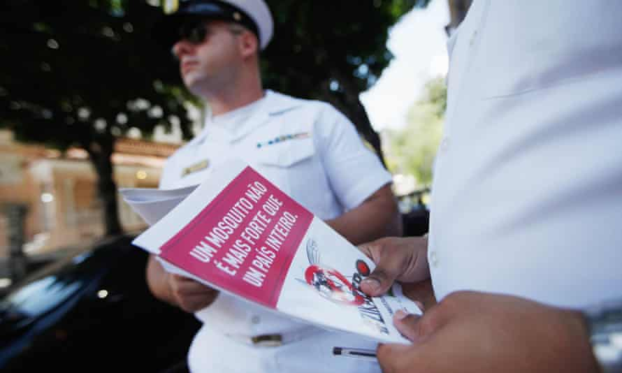Brazilian navy sailors prepare to pass out pamphlets warning of the dangers of the Zika virus and how to protect against mosquitos in Rio de Janeiro.