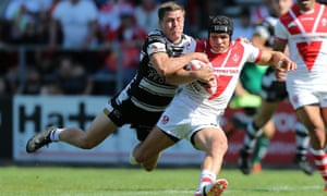 Jonny Lomax of St Helens is caught by Jamie Shaul in the Challenge Cup quarter-final.