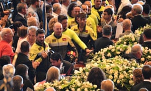 Firefighters are applauded as they pay homage to the victims of the Morandi bridge collapse