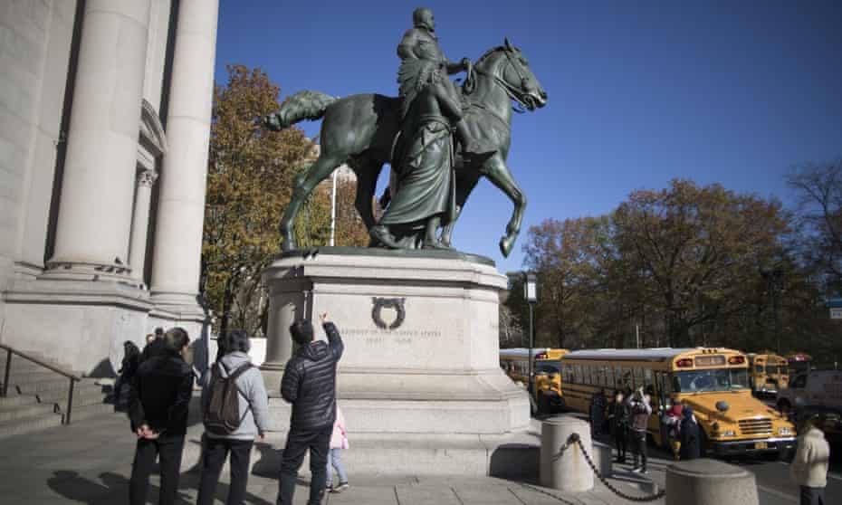Protesters have demanded the removal of a statue outside the American Museum of Natural History featuring Theodore Roosevelt flanked by an African American and a Native American.