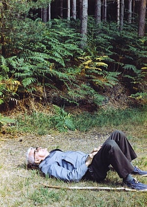 Man lying on his back on grass with his knees up