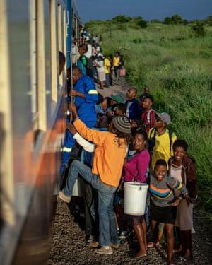 Commuters clamber aboard