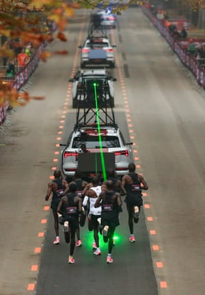 Lasers projected from a support car were used to help pacing and positioning for Kipchoge's 41-strong team of pacesetters, who rotated seven at a time.
