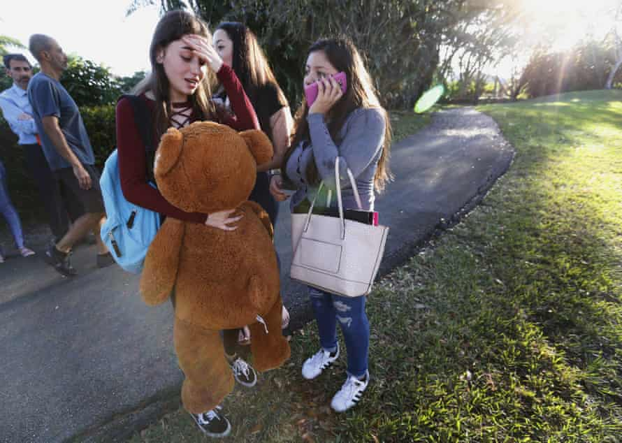 Students wait to be picked up after the shooting.