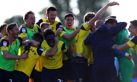 Oxford United players celebrate after Cameron Brannagan's winning penalty in the semi-final shootout.