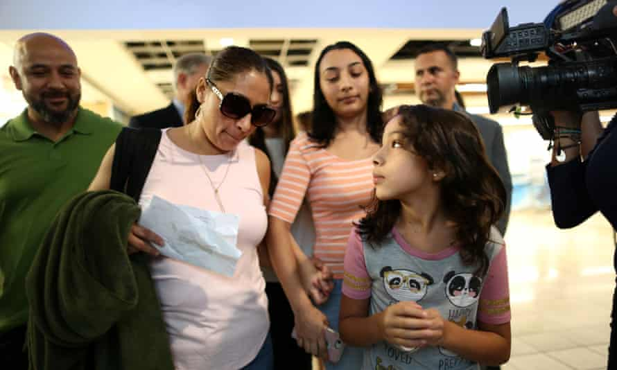 Alejandra Juarez walks with her two daughters, Pamela, 16, and Estela, 9, and her husband Temo Juarez, a former US Marine, to the departure gates at Orlando international airport for her deportation flight to Mexico.