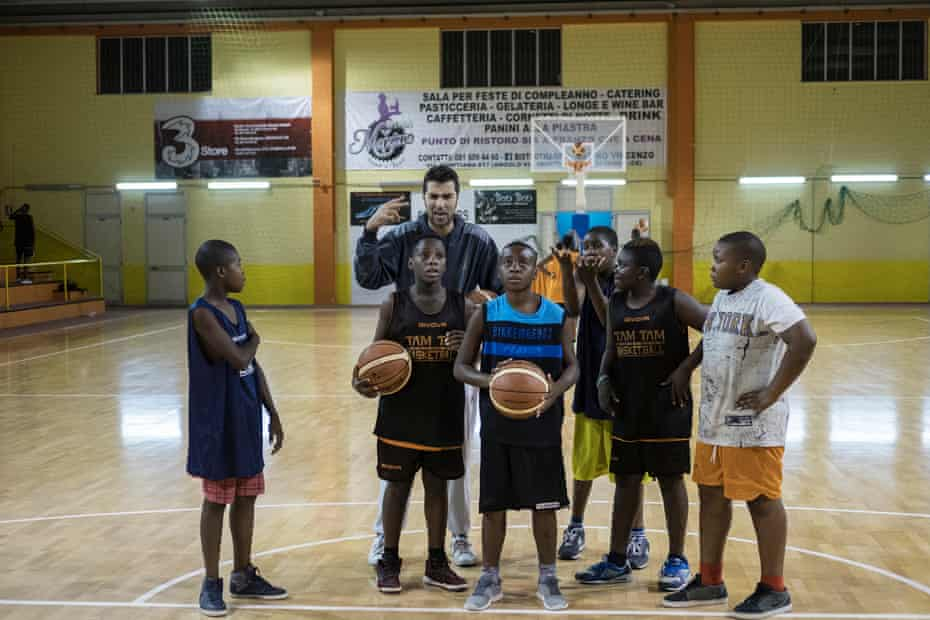 One of the Tam Tam coaches, Andrea, helps the players with their shooting