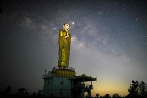 The Milky Way is seen behind a statue of Buddha in Myanmar