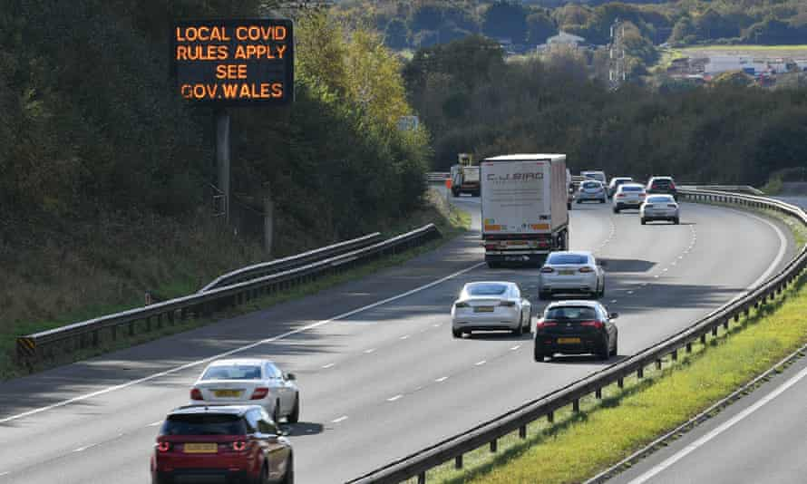 A sign on the M4 near Cardiff reminds motorists of coronavirus rules.