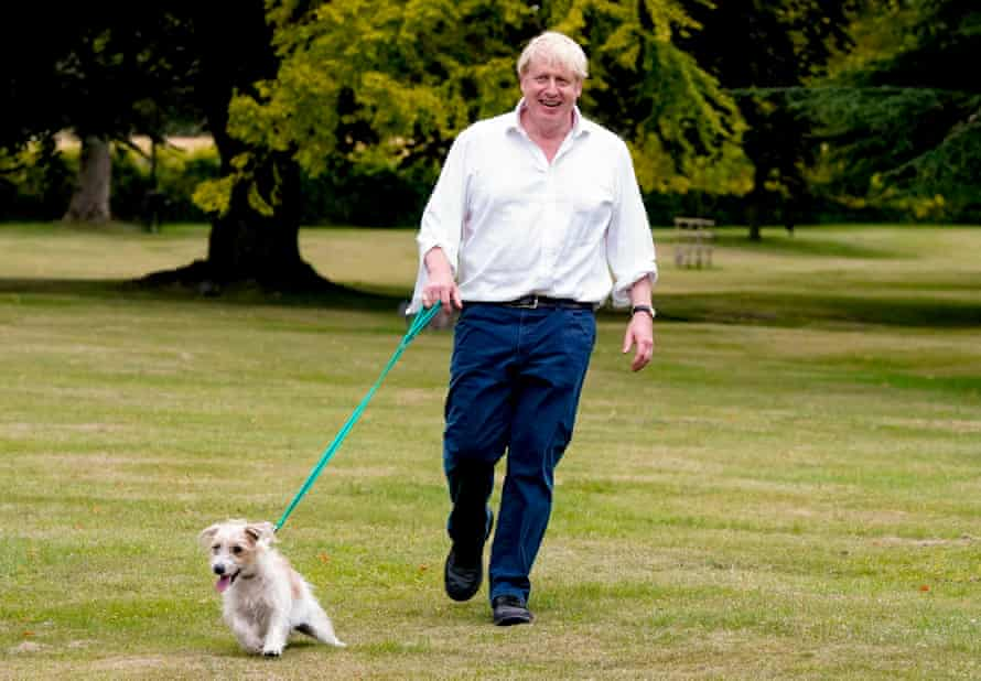 Boris Johnson takes his dog Dilyn for a walk in the grounds of Chequers as he encourages people to exercise for better health.