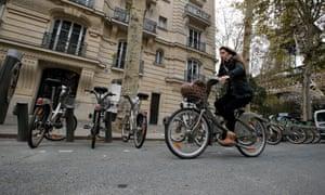 French student Alienor Saguez rides a Vélib' bike-share cycle in Paris.