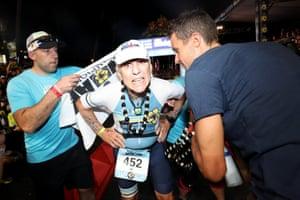 Kailua-Kona, Hawaii: Al Tarkington, 80, from the US, finishes the Ironman World Championship