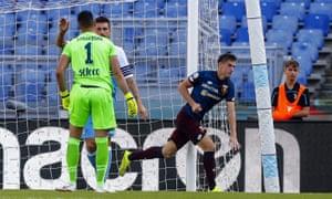 Genoa's Krzysztof Piatek celebrates after scoring against Lazio.