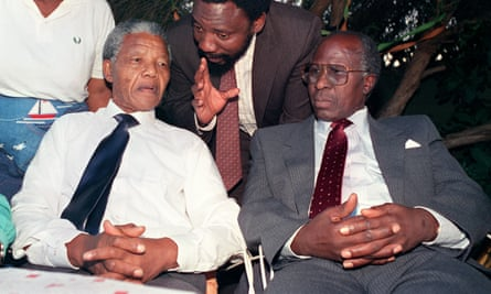 Nelson Mandela and Andrew Mlangeni listening to a young Cyril Ramaphosa in 1990