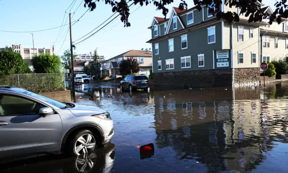 A stranded car in flood water is seen on Lester Street on Thursday in Passaic City, New Jersey.