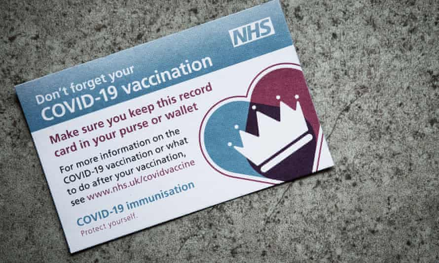 An NHS Covid vaccination record card, used to log details of vaccinations given.