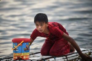 Cavesirano paddles his makeshift craft