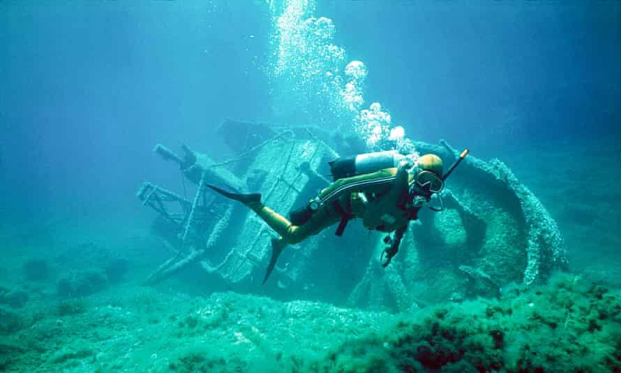 scuba diver with shipwreck underwater in Gozo Malta