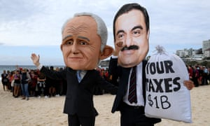 Protesters depict Malcolm Turnbull and the Adani founder.