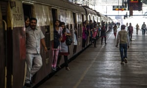 Passengers at a train station in Mumbai
