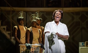 Sharon D Clarke in the title role, with the girl group personifying her radio, in Caroline, or Change.