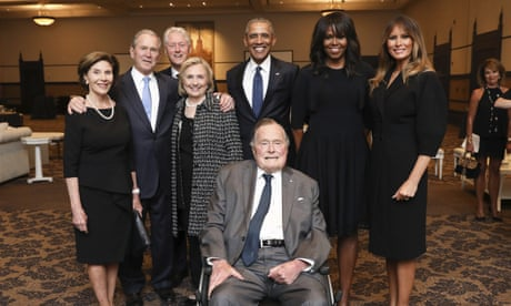 Why are the Bushes, Clintons, Obamas and Melania smiling so broadly at a funeral?