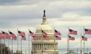 Flags fly by the US Capitol, in Washington D.C.