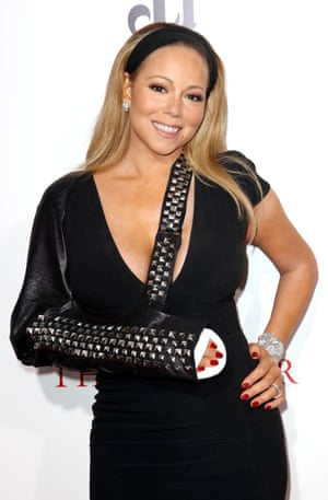 Following a dislocated shoulder on a video shoot, Mariah sported a series of bling slings on the red carpet and at a charity performance, including a black feather one.