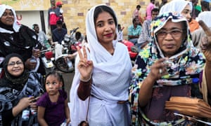 Alla Salah, whose protest against Bashir propelled her to internet fame, flashes a victory sign in Khartoum on Wednesday.