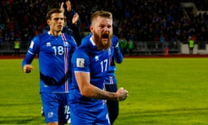 Iceland captain Aron Gunnarsson celebrates his team's win over Finland.