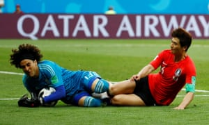 Guillermo Ochoa is challenged by Ki Sung-yueng