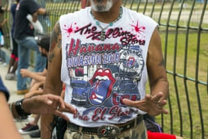 Wearing a T-shirt designed for the occasion, John Sanchez, a Vietnam veteran from Daytona, waits to enter concert venue
